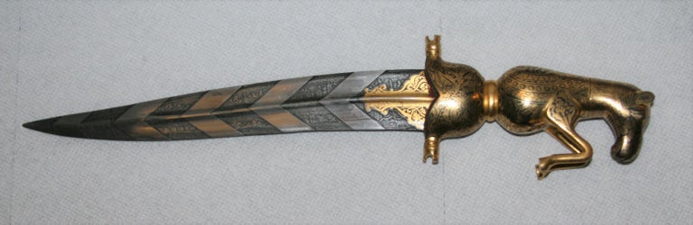 This is an extraordinary dagger with the hilt and metallic sheath completely filled with damascened gold work. The most important part, the blade is watered damascus steel. Please see close ups of both sides of the blade and view the inimitable
