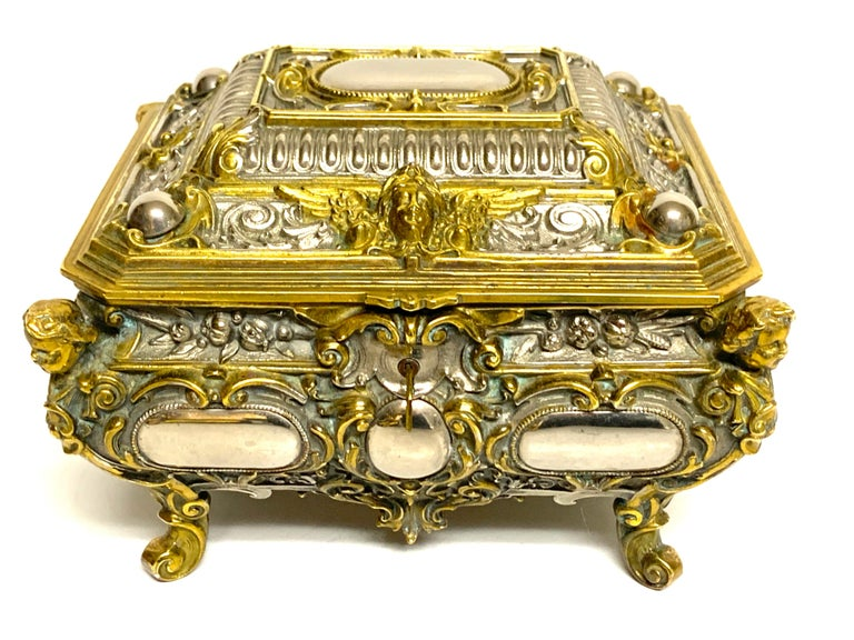 Magnificent silvered bronze and ormolu jewelry/table box, a substantial heavy weight box with Intricate detail with the silvered bronze resembling mirrors, with ormolu mounts. Complete with a very secure lock with two working keys. The interior