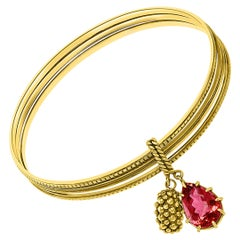 Magnificent Three Yellow Gold Bangle Attached by Pink Tourmaline and Gold Charm
