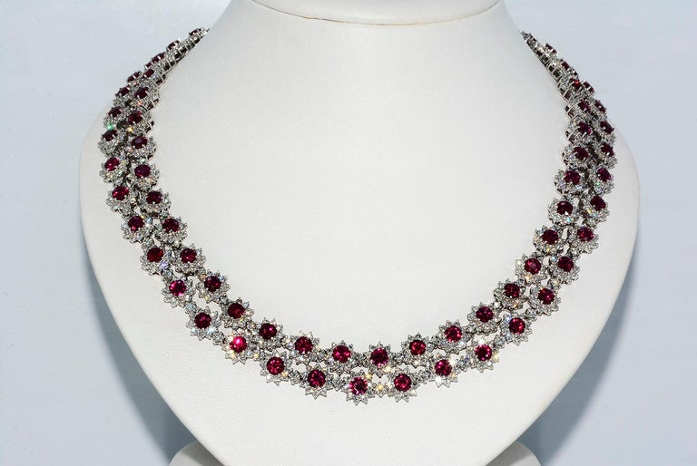 Magnificent Vietnamese Round Ruby Necklace and Matching Earrings 18k White Gold  NECKLACE Round Vietnamese Rubies 36.07 ct Round Diamonds 20.04 ct F VS1 18k White Gold Length 16 Inches 89.9 Grams  BRACELET   Round Vietnamese Rubies 8.74 ct Round