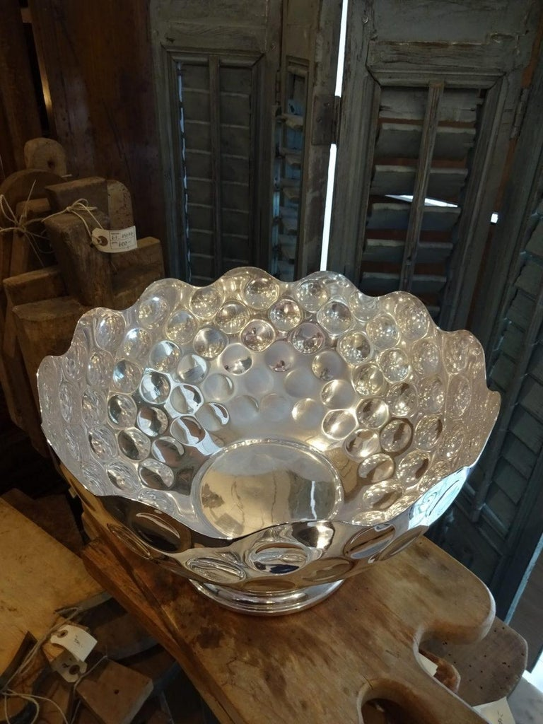 Very elegant silver plated champagne cooler, from France. Designed to represented half a golf ball, the cooler comes from an old and distinguished golf club in the South of France. Could quite easily accommodate a couple of magnum bottles or