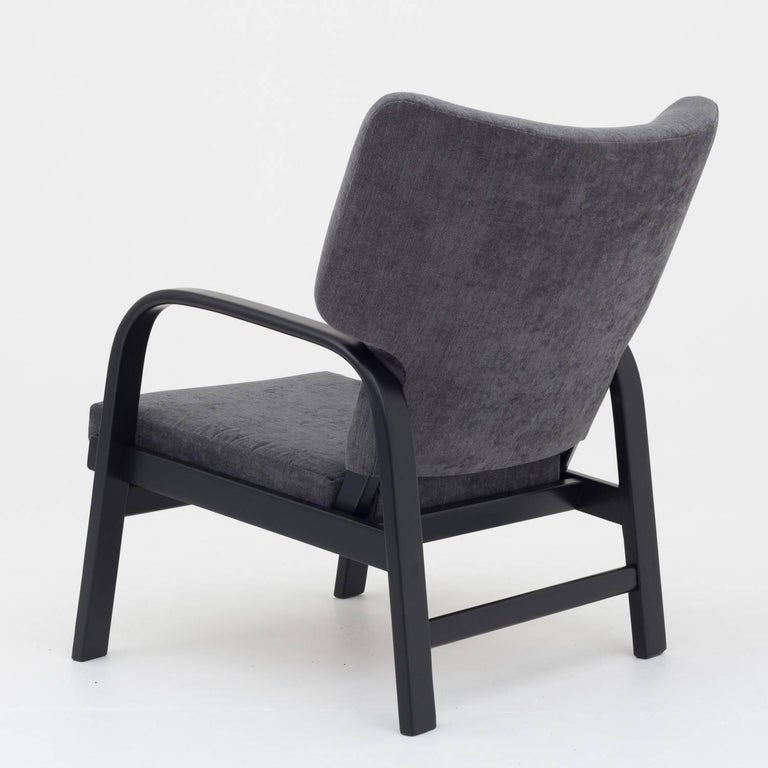Easy chair black lacquered frame and reupholstered in maple fabric col. 192. Made by Fritz Hansen.