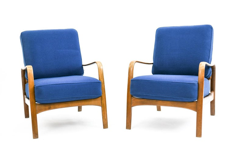 This sofa suite was designed by Magnus Stephensen for Fritz Hansen as an early example of Danish Mid-Century Modern style, circa 1930s-1940s. The suite includes loveseat and a pair of lounge chairs with rounded arms and blue upholstery.