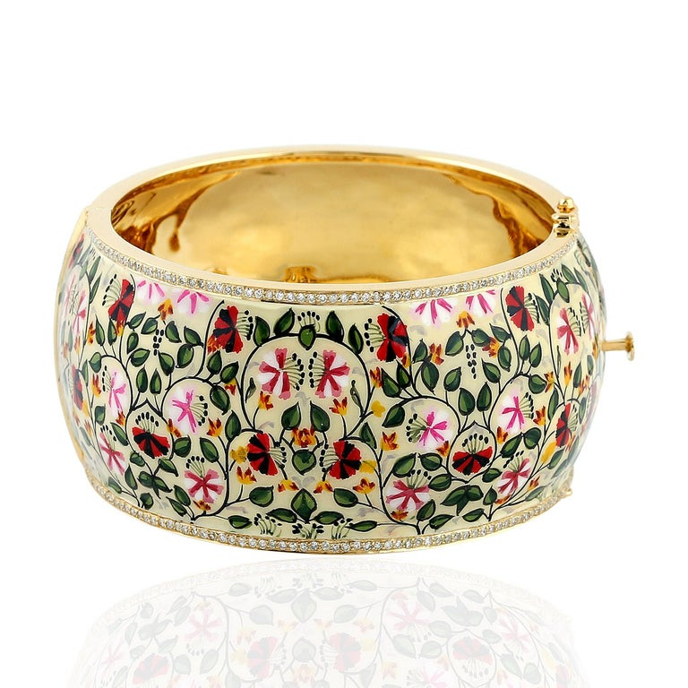 The pieces in Maharaja collection features unique hand painted miniature art set with 18K gold, sterling silver & 2.28 carats diamonds.  This beautiful bangle is filled with intricate floral art in ivory, red & green leaves. Clasp closure.  Please