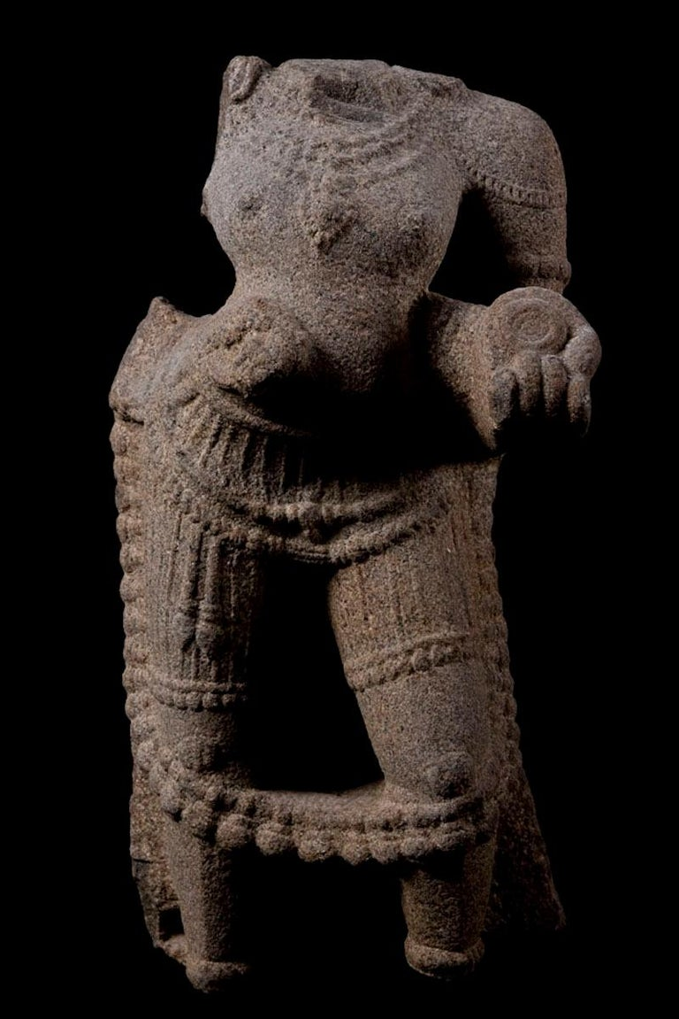 Maharaja granite torso with dagger and offerings, bell chain and dhotti.