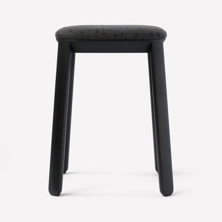 Covered Stool by Scholten & Baijings Small Dot Pattern by Charles and Ray Eames, 1947 105 Charcoal  Tinted beechwood base with Small Dot pattern textile. Stackable. Made in Japan by Karimoku New Standard.  Scholten & Baijings for Maharam is a