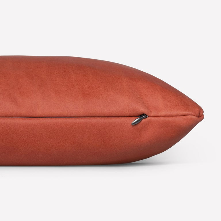 Maharam Pillow Loam 001 Terracotta   Guided by the Maharam Design Studio's material expertise, Loam celebrates the inherent beauty of leather returned to a more natural state. Sourced in Italy, Loam is a lightly sanded nubuck with a soft, matte