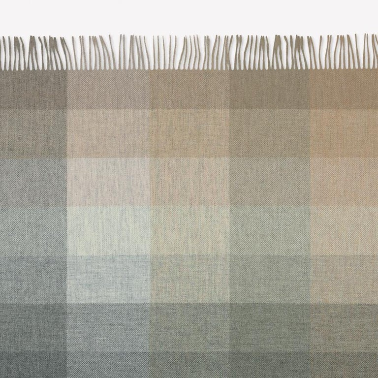 Maharam throw Wool check by Paul Smith 001 Birch  A natural extension of Maharam's work with textiles, wool check throw was developed based on a woven upholstery designed by Paul Smith in collaboration with the Maharam Design Studio. A study of