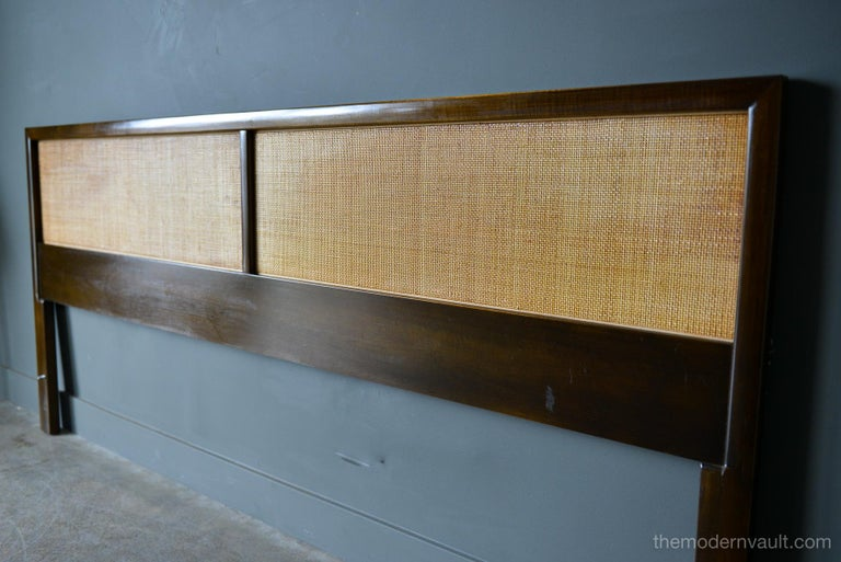 Mahogany and Cane King headboard, circa 1965 in the style of Harvey Probber or Edward Wormley for Dunbar. Beautiful cane with ribbon mahogany frame. Cane is in very good condition, with good patina and no breaks. Some slight fading to top of