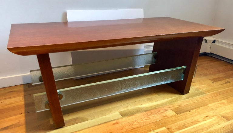 """Interesting circa 1940s French modernist design employing the high/low mix strongly associated with the designs of Jacques Adnet in this period. Chunky, almost rustic slab mahogany veneered top and slightly angled trestle legs, joined by 1"""" thick"""