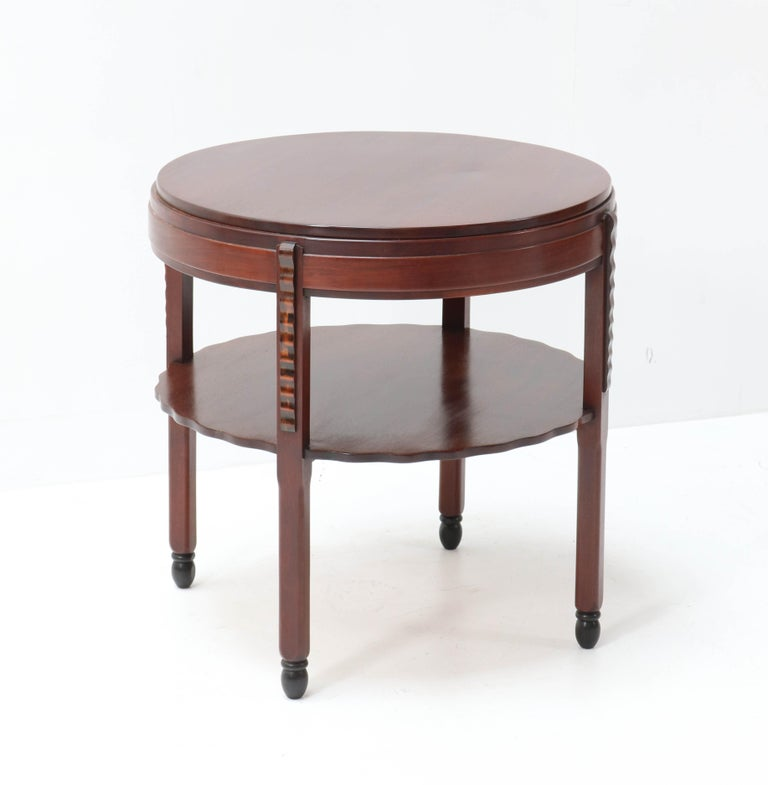 Stunning and rare Art Deco Amsterdam School coffee table. Design by Fa. Drilling Amsterdam. Striking Dutch design from the 1920s. Solid mahogany with solid macassar ebony lining. In very good condition with a beautiful patina.