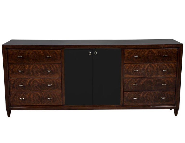 Mahogany Art Deco inspired cabinet buffet. This luxurious Art Deco mahogany cabinet features drawer faces with custom stainless steel ring hardware, accentuated with black goatskin finished parchment doors for a luxe, sleek and refined look.