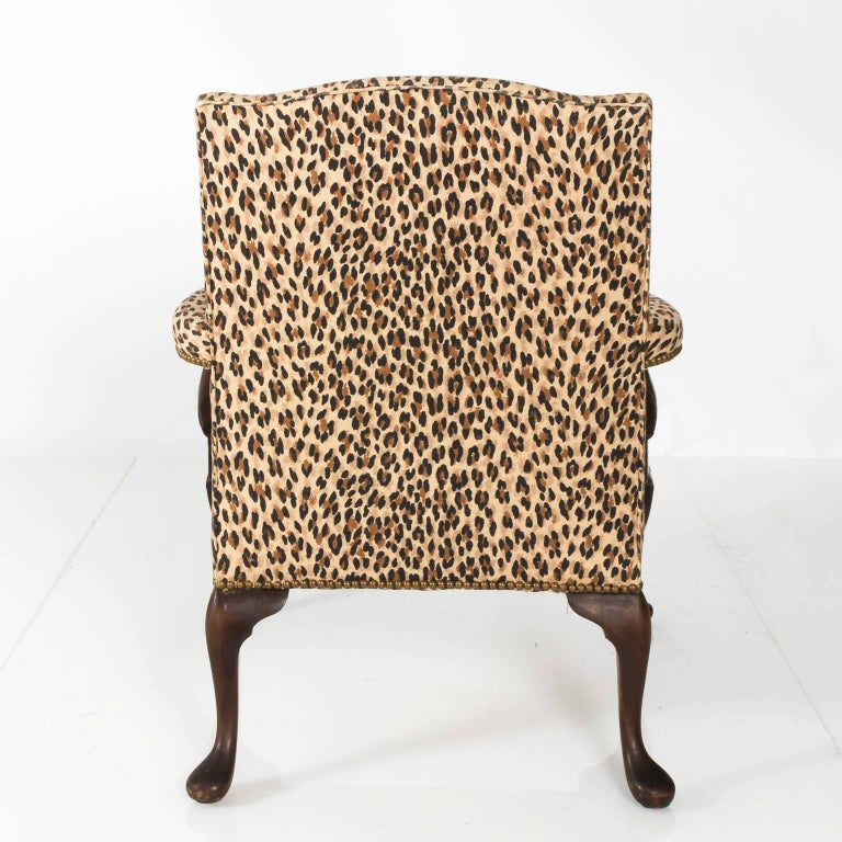 Carved mahogany open arm Bergere chair that features cabriole legs with pad feet and custom upholstery, circa 1900-1920.