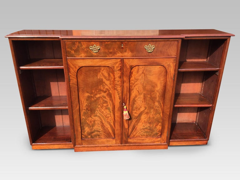 Attractive mahogany break fronted bookcase, English, circa 1860.
