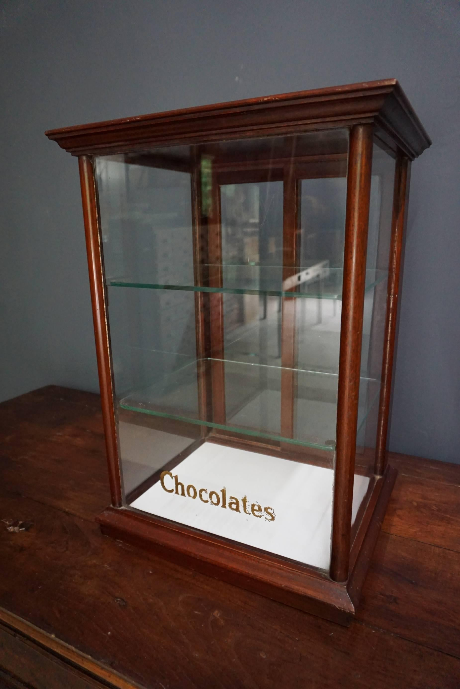 This Shop Display Cabinet Is Made From Mahogany, The Glass Has Gold Leaf  Lettering On