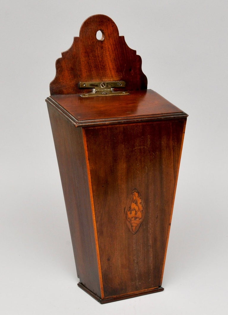 Candle box, circa 1790  Measures: H 46cm, W 21cm, D 14cm   An interesting mahogany candle box with shell inlay detail on the front and lovely brass hinge. In excellent condition and beautiful color.