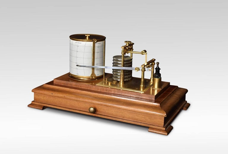 Mahogany cased barograph, by Lennie of Edinburgh having five glazed removable lid, and a drawer below to house the charts. The mechanical eight-day movement is housed in the drum, fitted with a seven-day chart which covers one full rotation of the