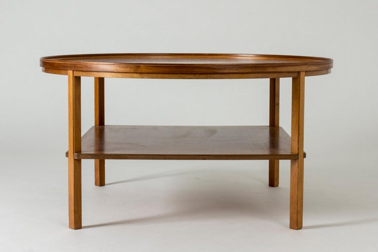 Round mahogany coffee table by Kaare Klint, model 6687, designed in 1929. Timeless and elegant with neat subtle details like the fitting of the legs into the lower shelf and the rim around the table top.