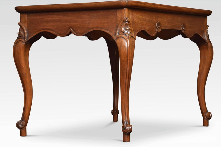 Mahogany coffee table the rectangular top with molded edge and re-entrant corners above the floral decorated frieze. All raised up on four cabriole legs terminating in scrolling toes. Dimensions: Height 17.5 inches Width 26.5 inches Depth 18