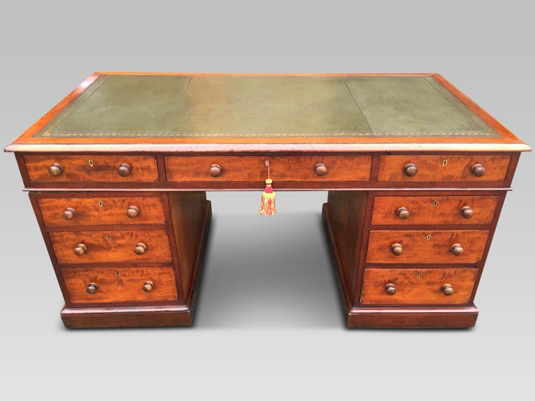 Handsome mid-19th century mahogany pedestal writing desk, English, circa 1850 This delightful desk has 9 smoothly running drawers with wooden knobs and is shown here in excellent condition. Made during the 1850s from solid mahogany, it is seen