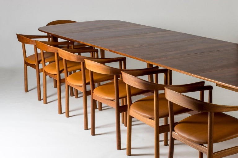 Amazing dining table by Josef Frank, made from beautiful mahogany. Rounded corners with an elegant inlaid line around the edge. The table has four extension leaves and seats fourteen people when fully extended. When three or four leaves are added,