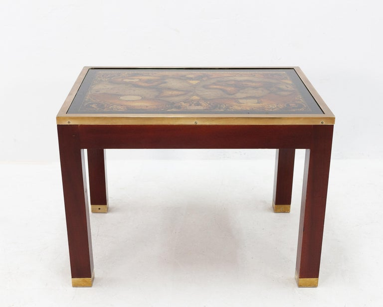 Mahogany side table with a solid brass edge and leg details featuring a glass world map on the top surface. Very nice side table. Maison Jansen, 1960s. Good condition.