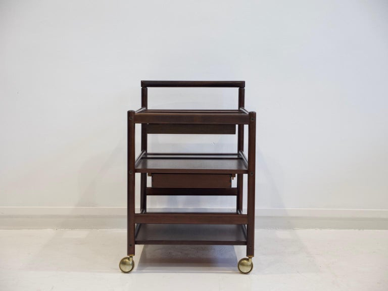 Mahogany serving trolley with shelves and drawers attributed to Johannes Andersen and produced by Dyrlund. This serving cart has been partially restored and it has a new top drawer. Original wheels.