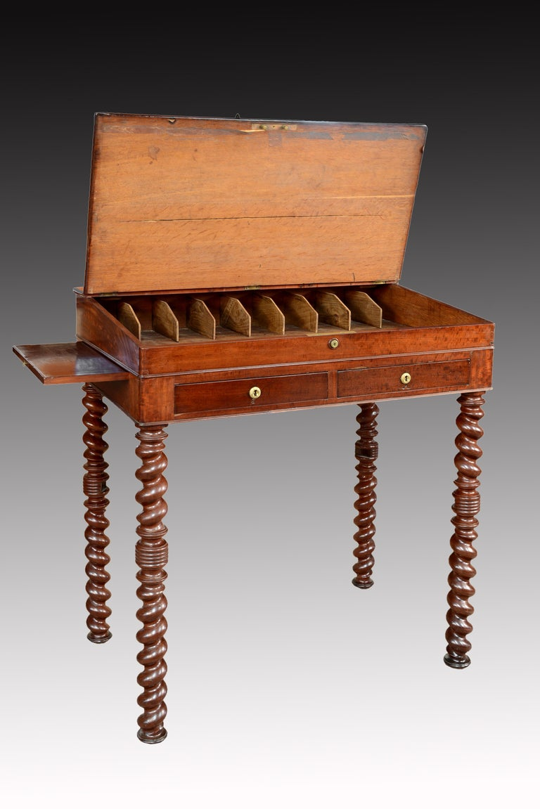 """Mahogany wood """"architect desk"""" table, France, 19th century. On four solomonic legs with a central knot stands the table, which has two drawers on the skirt, some boards on the sides and a sloping top. Inside, a large empty space is located under"""