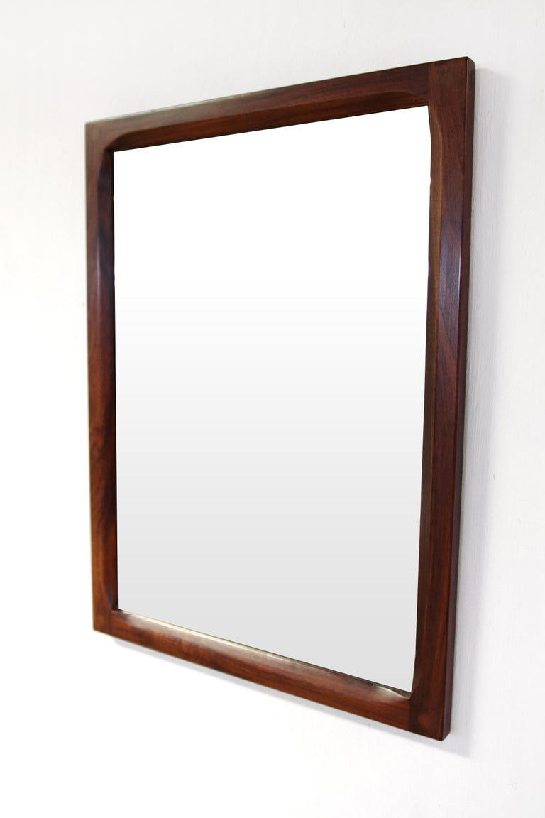 Very beautiful hardwood mirror designed by Kai Kristiansen and produced by Aksel Kjersgaard in Odder Denmark. It is often mistakenly thought that Aksel Kjersgaard is the designer of these mirrors, but Aksel Kjersgaard was the producer who put a