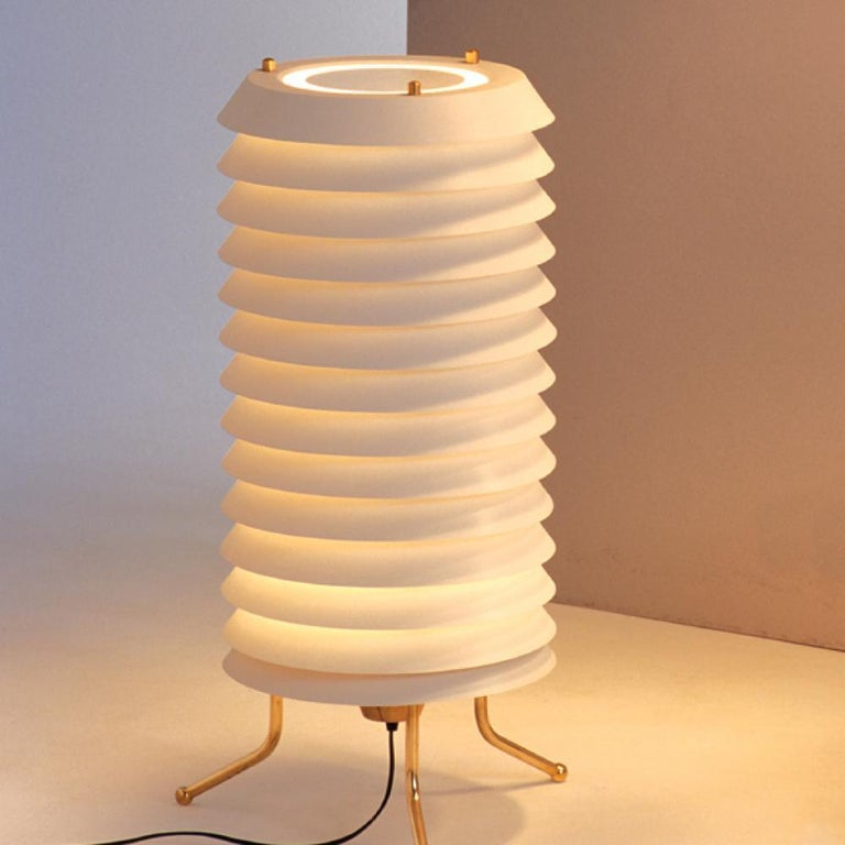 The timeless 'Maija Mehiläinen' lamp series was designed by Ilmari Tapiovaara in 1955. The Finnish designer drew his inspiration from Waldermar Bonsels' children's book 'Maya the Bee' (Maija Mehiläinen in Finnish), which is evident in the distinct,