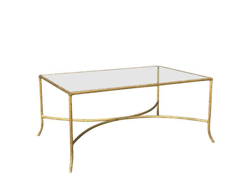 Rectangular glass top set in a cast faux bois frame, conforming legs and reverse C-stretcher.