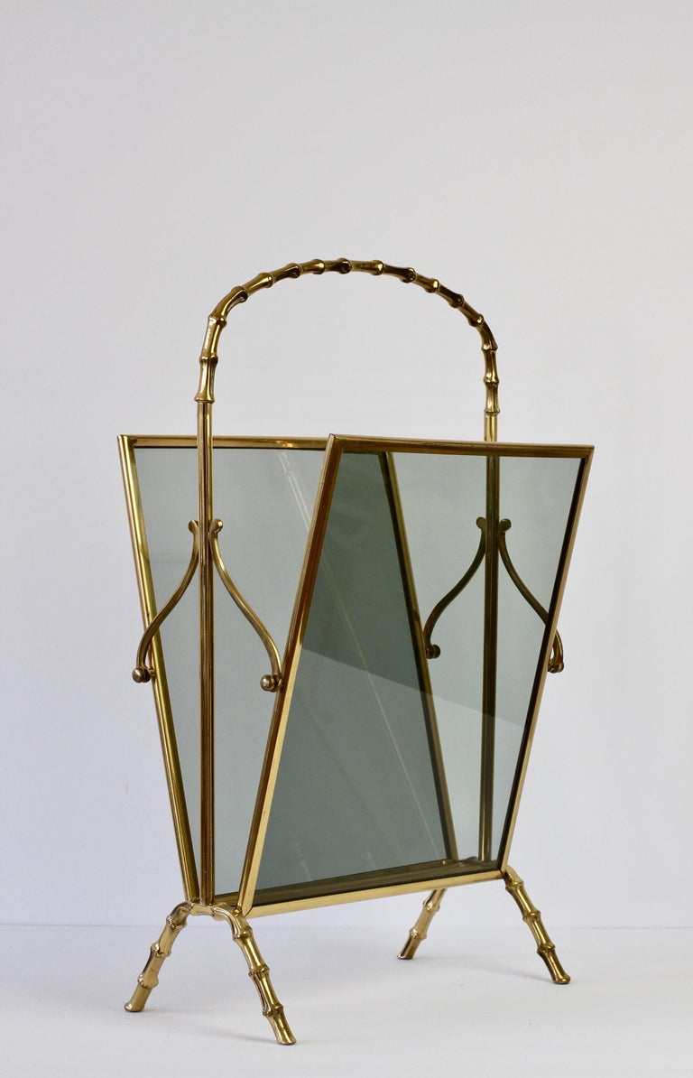 Maison Baguès attributed cast brass and smoked dark toned glass magazine / newspaper / book rack, holder or stand - perfect for the Hollywood Regency style - in faux bamboo. Made in France circa 1950s, perfect for any midcentury collector or