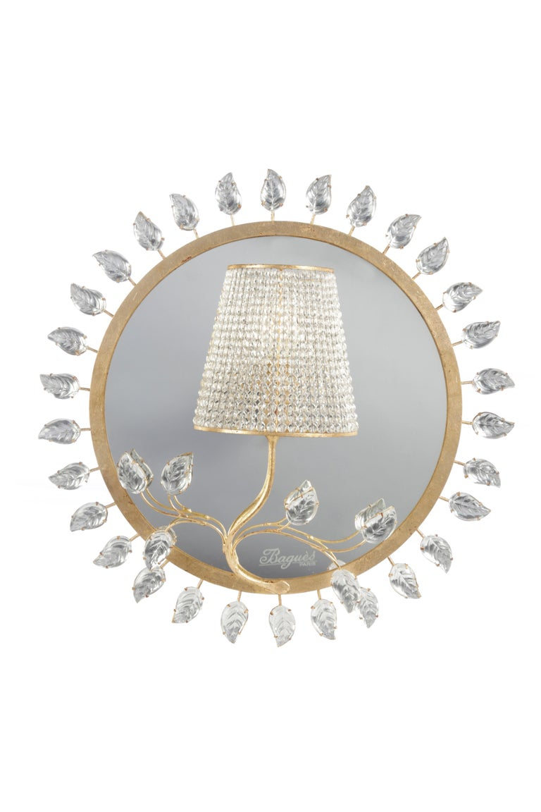 #18111, one light wall sconce in leaf gilt silver. Iron and crystal (UL listing available for an additional fee). with mirror backing. Made by Maison Bagues in France.