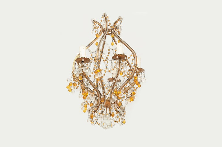 This chandelier is perfect for a small room in the house, he got a very good luster, give a touch of French Luxury. The arms are in Guilt metal, with glass beaded, all around.