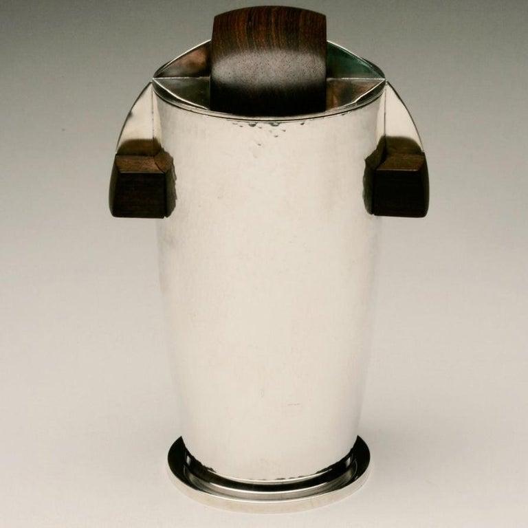 Maison Bloch Eschwege .950 Silver and wood Art Deco cocktail Shaker/urn.  Retailed via New York luxury retailer Chatillon Co., Inc.  Maker: Maison Bloch Eschwege  Circa: 1921-46   Dimensions: 8