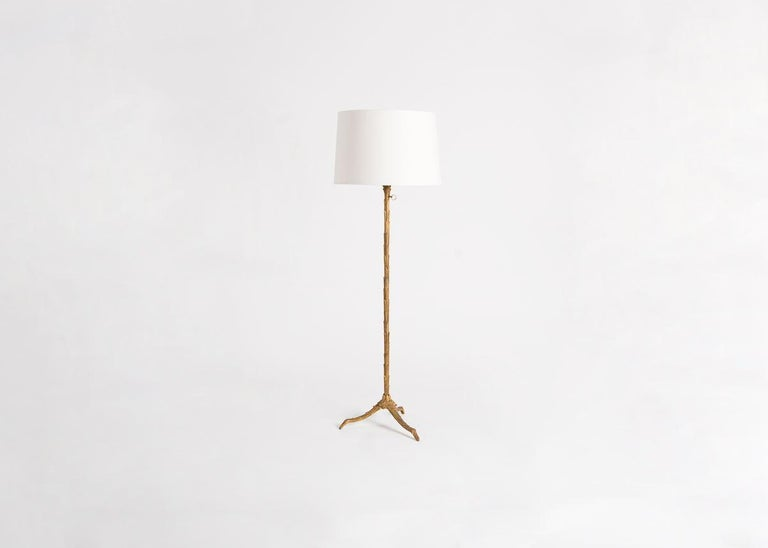 Adjustable height bronze floor lamp by Maison Charles. Stamped on base.  This model is illustrated in L'e´clairage dans la Maison, Editions Charles Massin, Paris, p. 50. and on p. 59 of the Catalogue E. A. Charles & Fils.