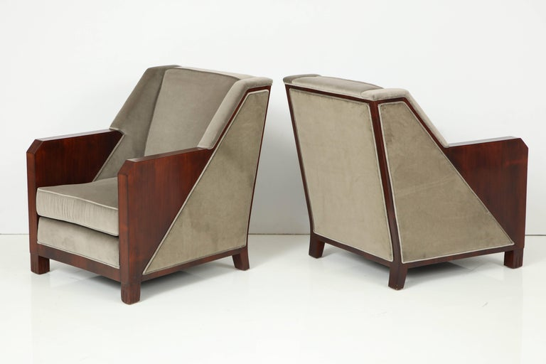 Pair of modernist rosewood armchairs by Maison Dominique, Branded signature to frame.
