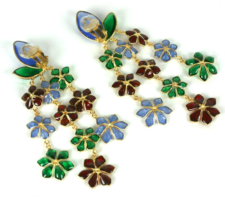 Exceptional Maison Gripoix Anglo Indian inspired long floral cascade ear clips. Of faux emerald, ruby, and pale sapphire poured glass enamel graduated flower heads set in fine glit metal frames. The impressively long earrings has clip back fittings