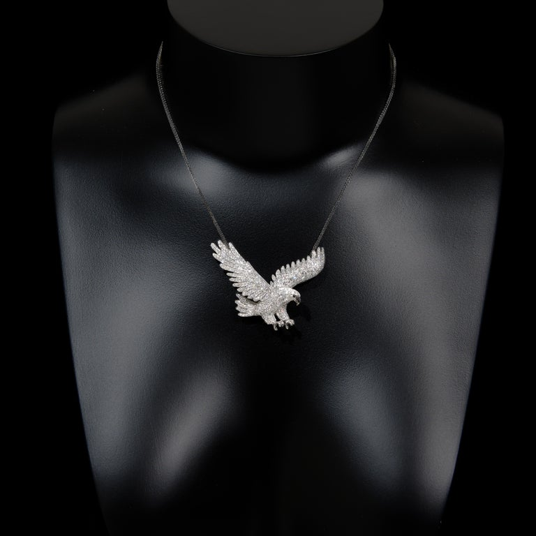 Contemporary Dive, 18 Karat White Gold, Sapphire, Diamond Brooch For Sale