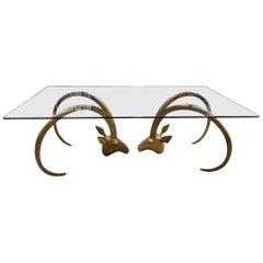 Maison Jansen and Chervet Style Brass Rams Head Glass Cocktail Coffee Table