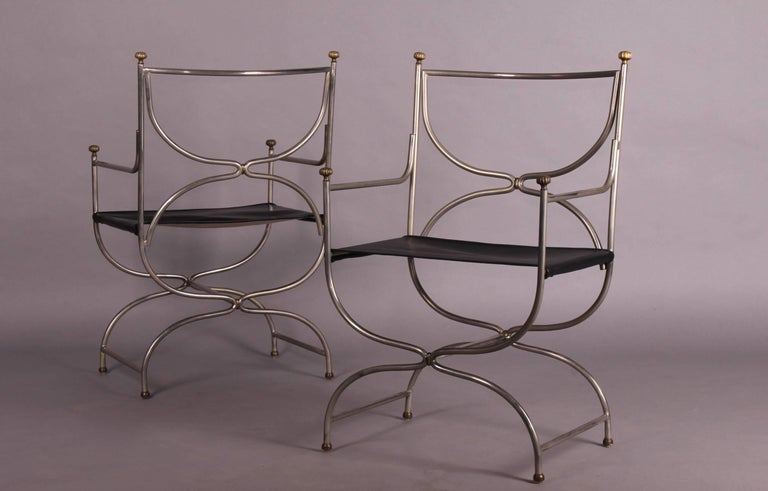 Maison Jansen armchairs pair, stainless steel, solid brass and black leather.