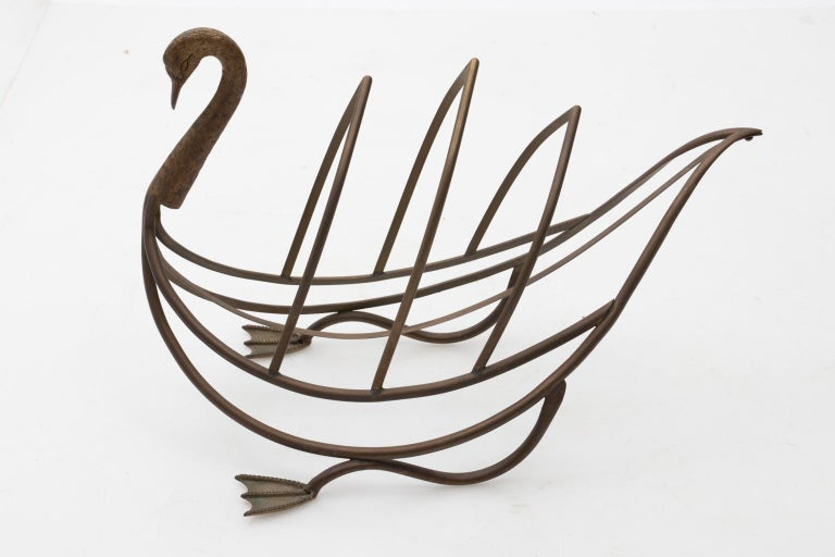 Maison Jansen brass magazine rack in the shape of a bird with original patina, circa 1960s. Please note of wear consistent with age including oxidation. Made in France.