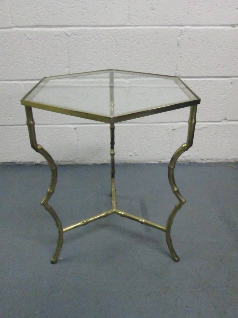 Bronze faux bamboo table in the manner of Maison Jansen. Has a hexagonal shape with glass top.