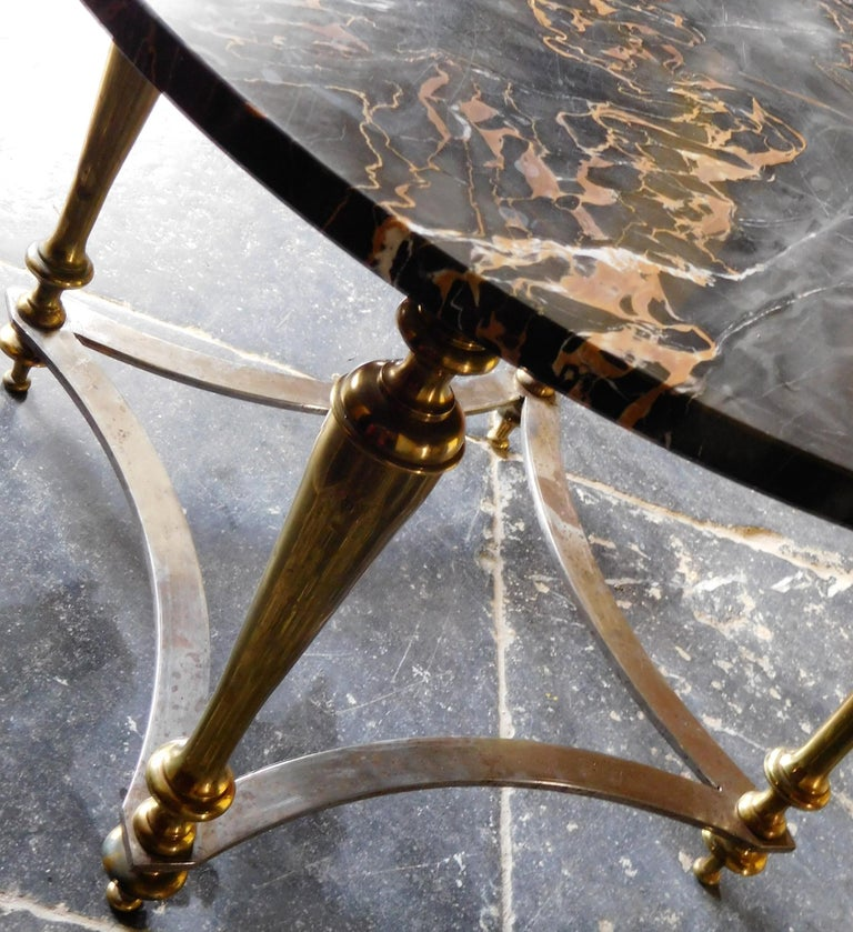 Mid-Century Modern, coffee table in perfect condition. Design Maison Jansen. Made of bronze, steel and with a beautiful Portoro-marble top, period 1960.