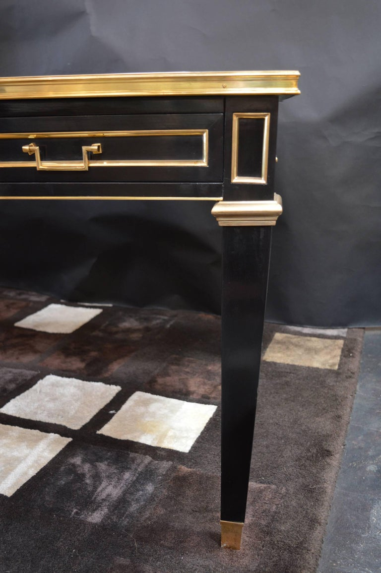 Louis XVI style ebonized bureau plat having inset leather top with bronze trim over drawers and supported on bronze mounted legs. From Jansen collections, launched in 1972 Four drawers.