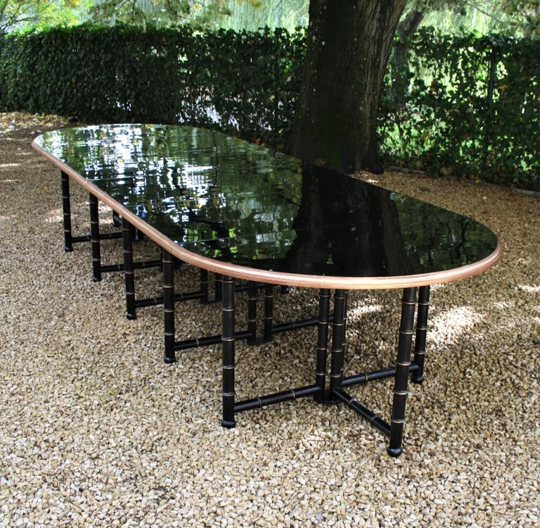 This extremely large table was commissioned for a country retreat in Normandy. This table can be used as a dining table or as a conference table. Made of lacquered and gilded beech wood and the tabletop is lacquered in high gloss black. The table