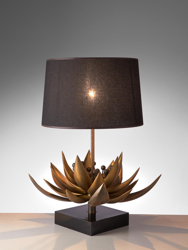 Christian Techoueyres for Maison Jansen, table lamp, brass, stone, France, 1970s.  This elegant and naturalistic table lamp bears strong traits of the Classic shaded desk light. The base holds a large flower shape, executed in brass. The direct