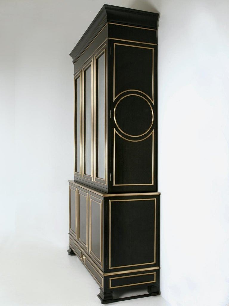 Maison Jansen inspired Louis XVI style bookcase or display cabinet, that was created in our old plank woodworking shop. This beautiful ebonized mahogany bookcase, was a custom creation and constructed to the highest standards, with attention to