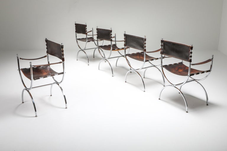 """""""Savonarola"""" Emperor chairs by Maison Jansen, 1970s.  Stunning set of five luxury Maison Jansen armchairs with elegant chrome frames and beautifully patinated thick brown leather, seats, back and armrests. Produced in France during the"""