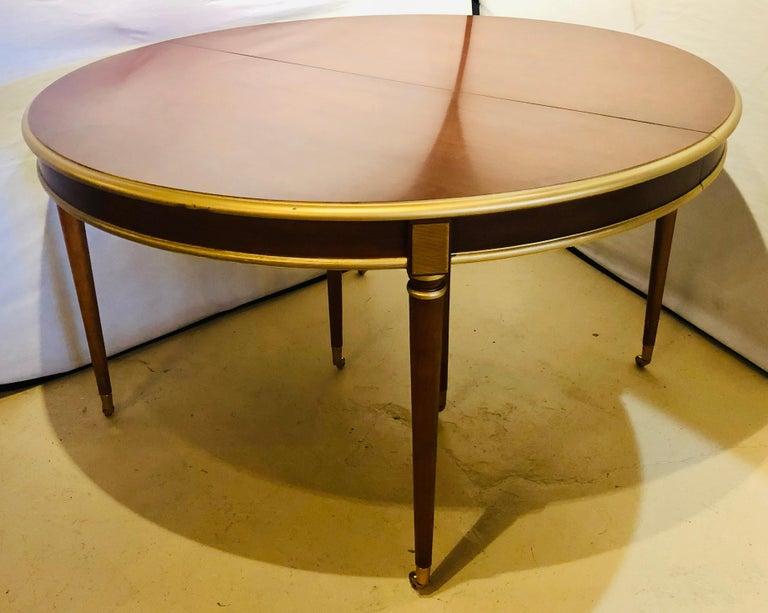 Hollywood Regency Maison Jansen Mahogany Louis XVI Style Circular Dining Table For Sale
